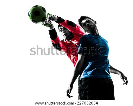 two  soccer player goalkeeper men punching heading ball competition in silhouette isolated white background - stock photo