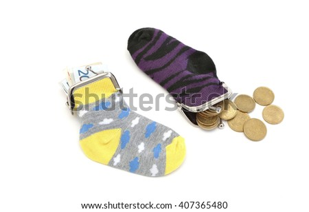 Two socks filled with euro notes and coins - stock photo
