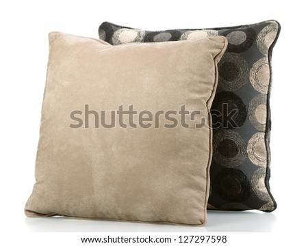 Two sofa pillows covered in neutral fabrics - stock photo