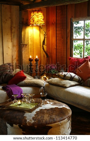Two sofas and a table in cozy country house - stock photo