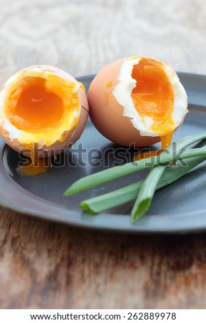 Two soft-boiled eggs on a tin plate. - stock photo