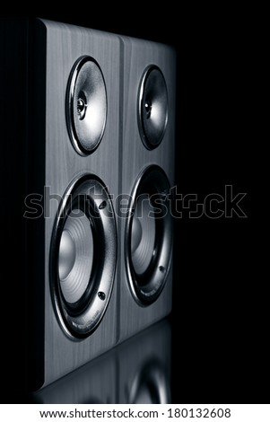 Two speaker systems on a black background - stock photo