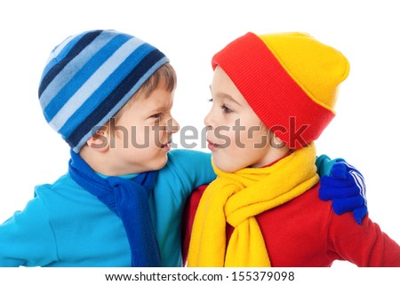 Two speaking kids in winter clothes showing a different emotions, isolated on white - stock photo