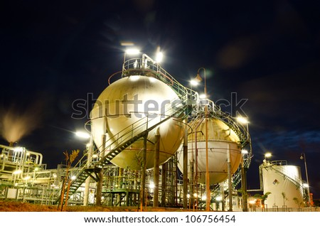 Two sphere gas storages in petrochemical plant  at night - stock photo