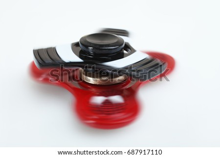 Two spinners spinning on a white background