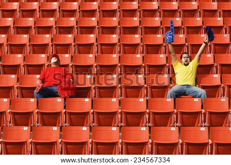Two Sports Fans in Stadium - stock photo