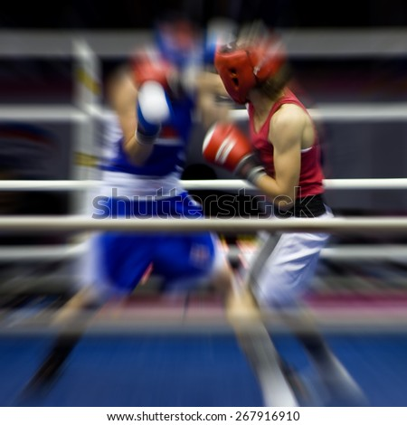 Two sportsmen boxing on a ring - stock photo