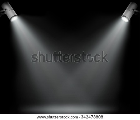 Two spotlights on black background - stock photo