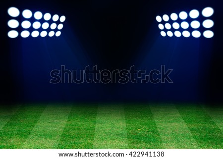 Two spotlights on football grass field. Empty place for text or product - stock photo