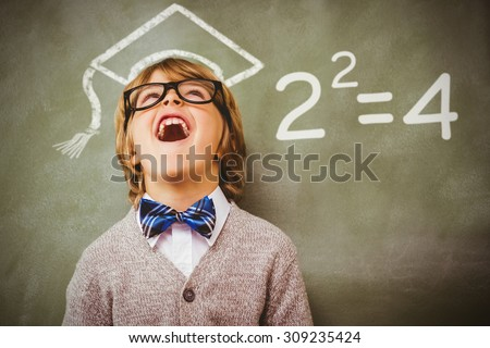 Two squared against boy laughing in front of blackboard - stock photo
