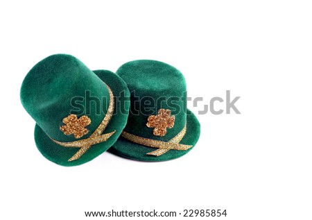 Two St. Patricks Day top hats isolated on white with copy space.