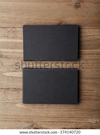 Two stack of blank black business cards on wooden background Vertical - stock photo