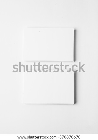 Two stack of blank business cards on white background with soft shadows. Vertical - stock photo