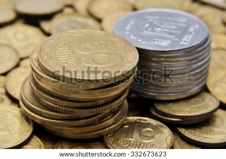 Two stacks of coins of yellow and white metal
