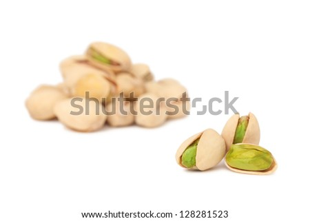 Two stacks of pistachios isolated on white background