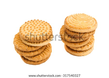 two stacks of tasty cookies on white closeup