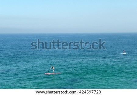 Two stand up paddlers in the Arpoador Beach, Rio de Janeiro - Brazil.