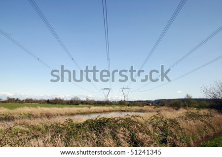 Two steel high voltage power line tower. - stock photo