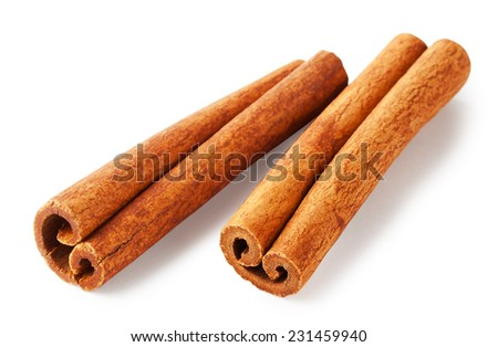 Two sticks of fragrant cinnamon isolated on white background - stock photo