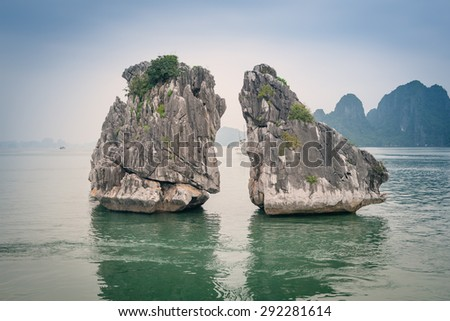 "Two stone cliff-island (""Cock and Hen"") in Halong Bay in Vietnam"