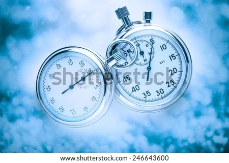 Two stopwatches on misty background in toning - stock photo