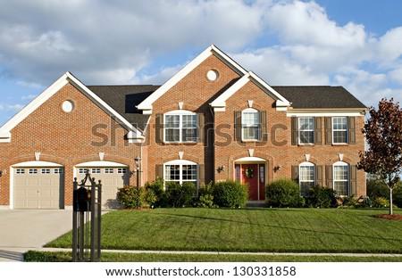 Two Story Brick House - stock photo
