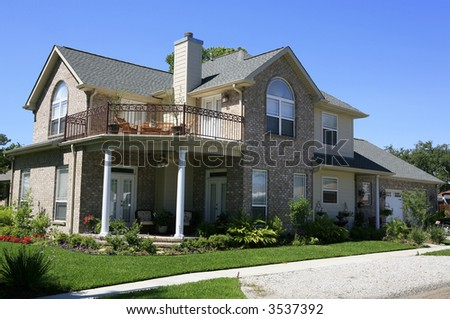 Two story brick house with double porches