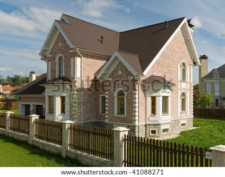 Two story cottage in suburbs - stock photo