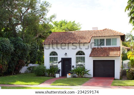 Two story house with a garage - stock photo