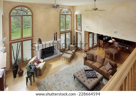 Two story living room in luxury home - stock photo