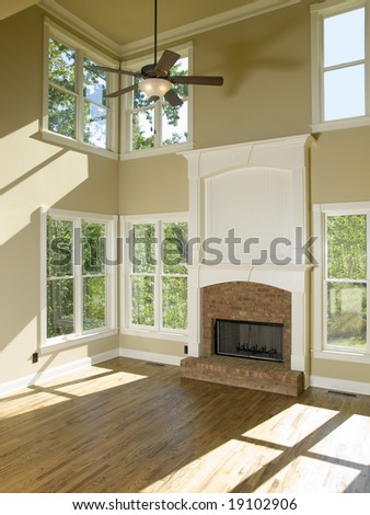 Two Story Living Room with fireplace