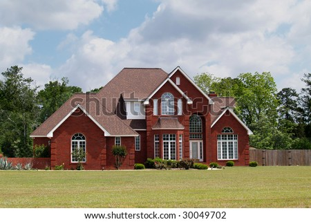 Two story residential home with brick facade. - stock photo