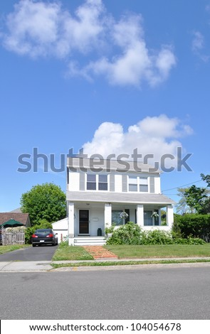Two Story Suburban Home Porch Brick Walkway Cement Sidewalk Curb Street Sunny Blue Sky Clouds - stock photo