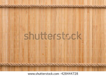 Two straight rope on a bamboo mat, with a place for your text - stock photo