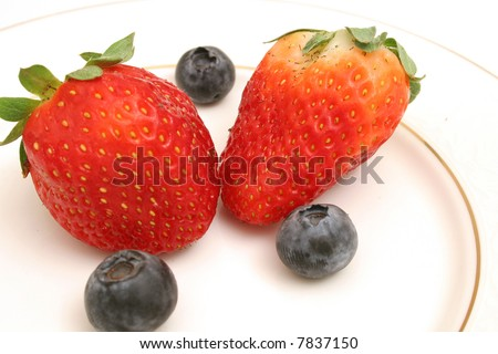 Two strawberries & blueberries angle - stock photo