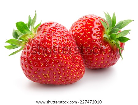 Two strawberries close up on white background - stock photo