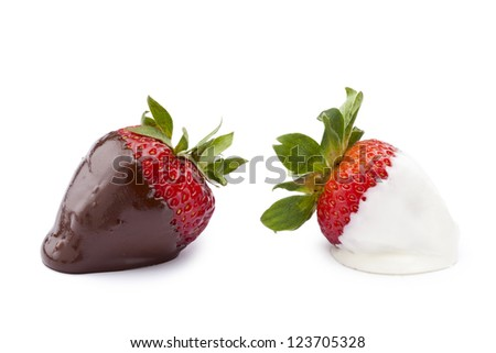 Two strawberries dipped in white and brown chocolate isolated in a white background - stock photo