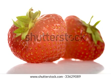 two strawberries, fresh and healthy, isolated on white