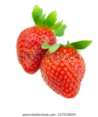 two strawberries isolated on white - stock photo