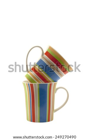 Two striped cups isoleted on white background - stock photo