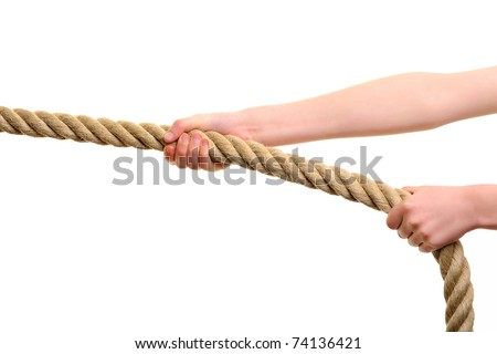 two strong hands pulling a rope to win - stock photo