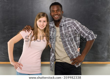 Two student in classroom. - stock photo