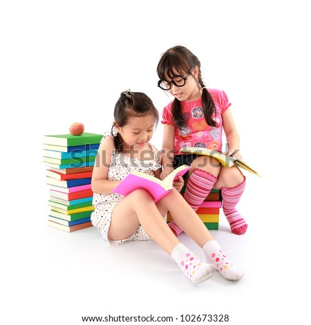 Two student little asian girl reading the book