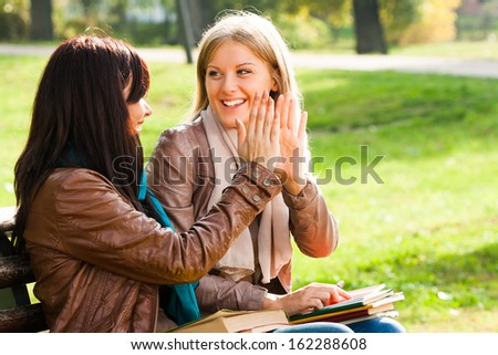 Two students are giving high five after successfully learning,High five! - stock photo