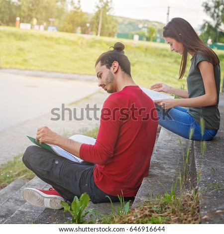 Two students learning outdoors