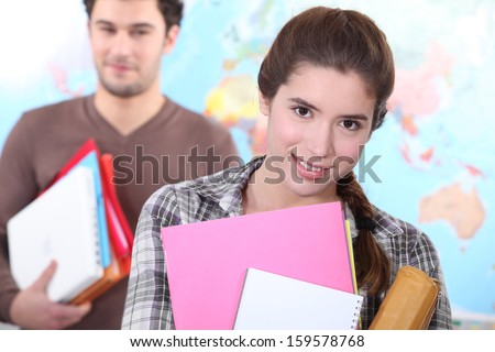 Two students leaving class - stock photo