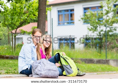 Two students sitting at school in recess
