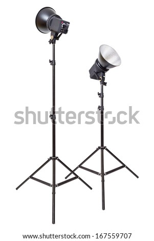 Two studio flash light monoblocks on tripods isolated on white background