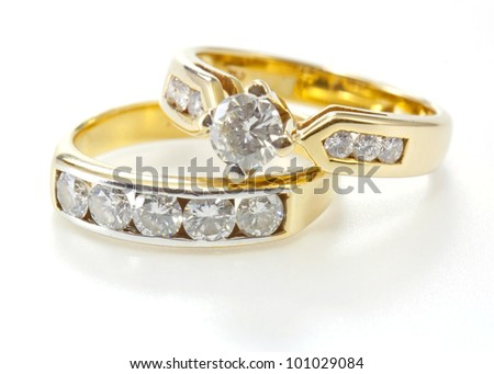 Two styles of golden ring with diamond isolated on white background. - stock photo