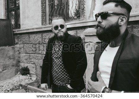 Two stylish bearded men on the background of the old town - stock photo